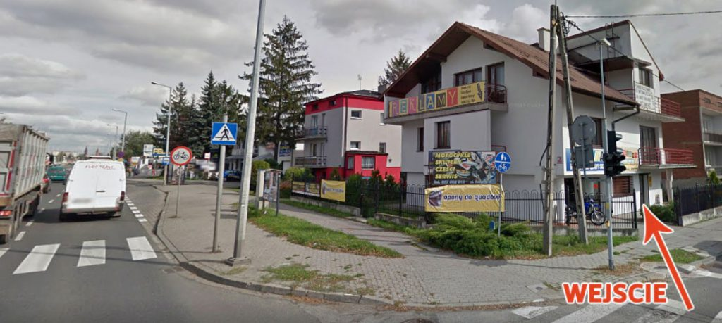 Wejście do biura reklamy róg ulicy Krakowskiej i Radosnej